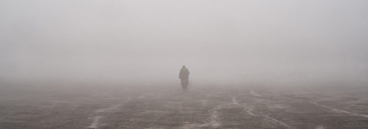 walking on a foggy beach