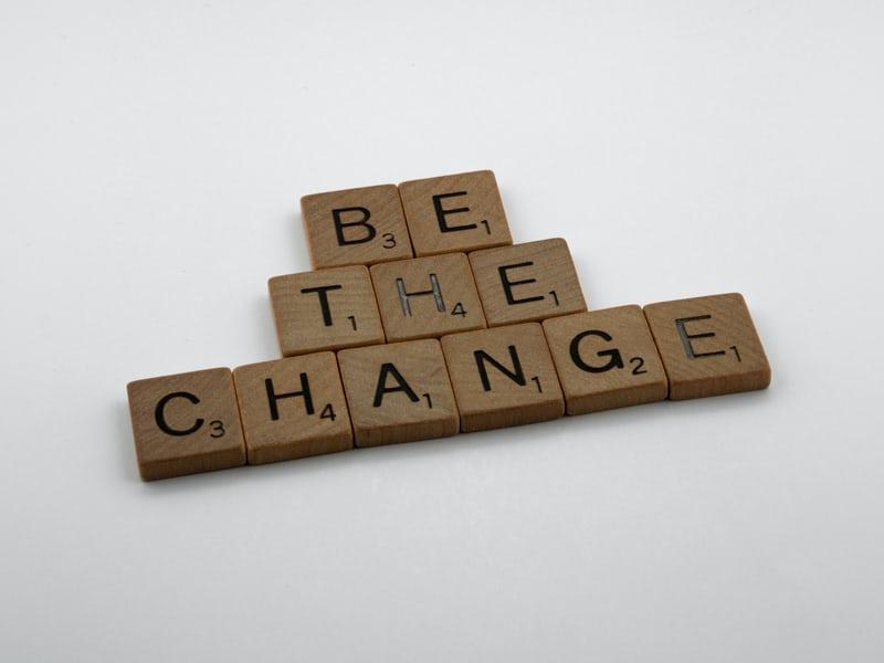 scrabble tiles spelling be the change