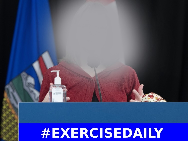 podium speaker with sign that says exercise daily