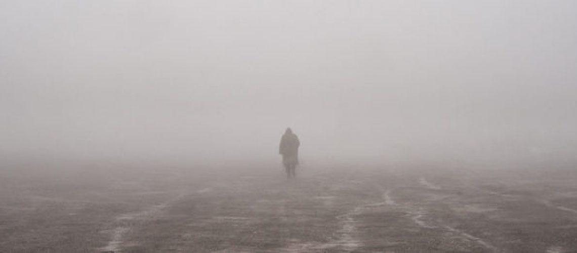 walking on a foggy beach
